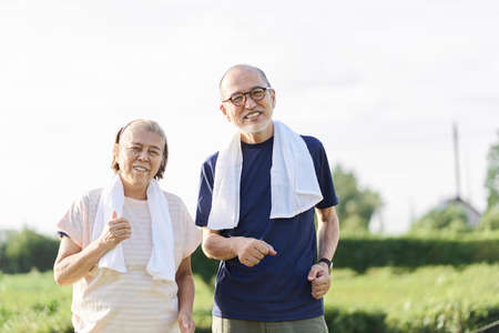 Elderly Asians jogging outside in the evening