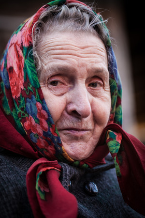 Smiling old woman with a scarf