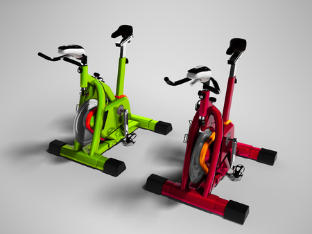 Modern green and red exercise bikes perspective 3d render on gray background with shadow Stock Photo