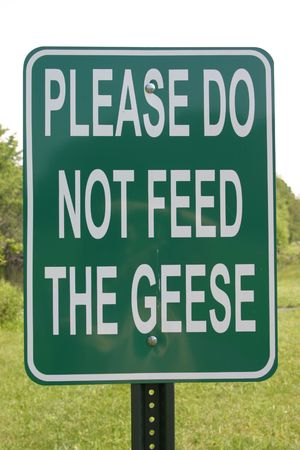 Sign Please Do Not Feed The Geese Reklamní fotografie