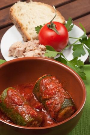 Zucchini stuffed with tuna typical dish of traditional Roman and Italian cuisine made from zucchini, tuna, bread crumbs and tomato sauce photo