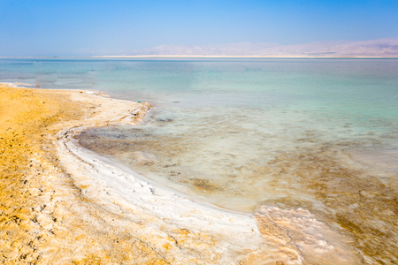View of Dead Sea coastline. Salt crystals at sunset. Texture of Dead sea. Salty sea shore