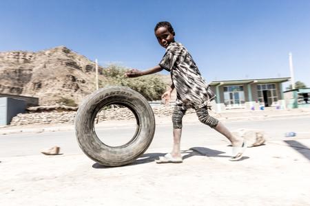 Mekelle, Ethiopia - NOVEMBER 30, 2017: children play with a tire around town.