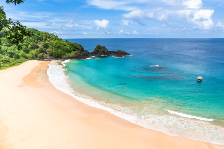 Fernando de Noronha, Brazil. Aerial view of Sancho Beach on Fernando de Noronha Island. View without anyone on the beach. Trees and plants around.