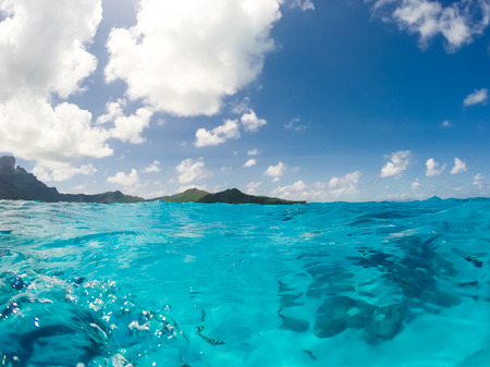 Bora Bora, French Polynesia. Snorkeling in turquoise waters. Pacific Ocean. 스톡 콘텐츠