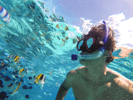 Bora Bora, French Polynesia. Snorkeling in turquoise waters. Pacific Ocean. 写真素材