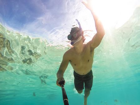 Stand up paddle in Bora Bora Island, French Polynesia. Standard-Bild