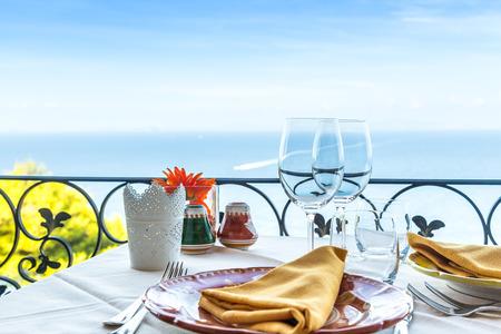 Restaurant table overlooking the sea on the Amalfi coast in Italy.