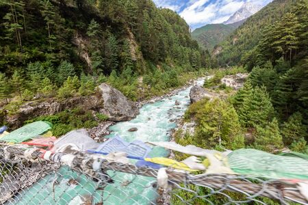 suspention bridge on the Everest Base Camp Trek, Himalaya mountains, Sagarmatha National Park, Nepal. Amazing river.