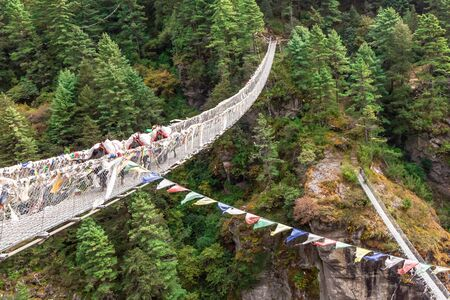 Suspention bridge on the Everest Base Camp Trek, Himalaya mountains, Sagarmatha National Park, Nepal. 写真素材