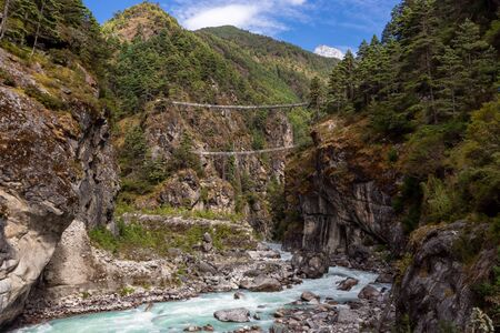 suspention bridge on the Everest Base Camp Trek, Himalaya mountains, Sagarmatha National Park, Nepal. Amazing river.