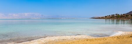 View of Dead Sea coastline. Salt crystals at sunset. Texture of Dead sea. Salty sea shore. Web banner in panoramic view. Stock fotó