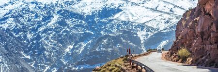 Atlas mountains in Morocco, Africa. Web banner in panoramic view. Road.