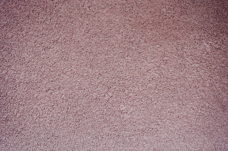 stucco: Pink bumpy rough plaster stucco wall surface background texture.
