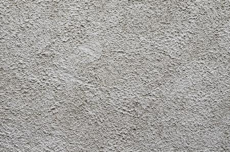 stucco: Gray bumpy plaster stucco wall surface texture.