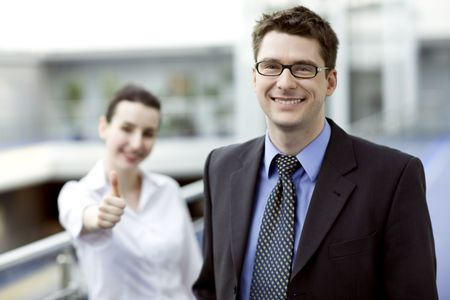 Business portrait - young handsom man with thumbs up sign in backgroud Stock Photo - 3090526
