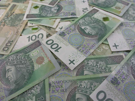 Polish Currency 100 Zloty Bills Cash on a Table