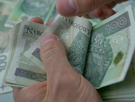 Counting Polish 100 Zloty Bills Cash