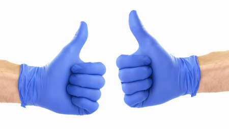 Thumbs Up Signal Shown in Blue Protective Surgical Gloves on White Background