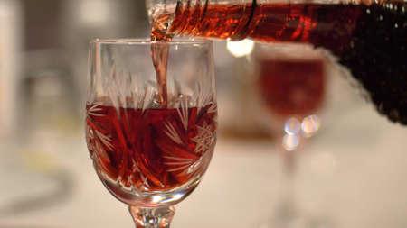 Pouring Red Alcohol Liquor Into Shot-Glass Close-Up Stock fotó
