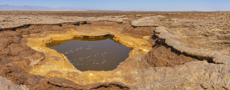 Acid bubbling pond in the Danakil depression in Ethiopia in Africa.