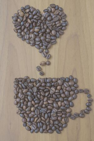 Cup of coffee and smoke drawn down with coffee beans.