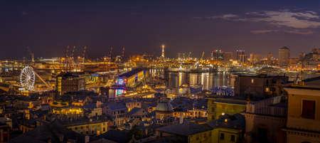Genoa, Italy - 09 19 2020: Genoa harbor from Spianata Castelletto by night.