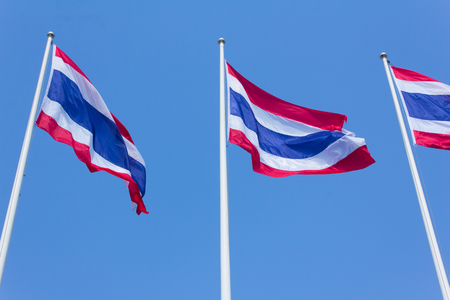 Flag of Thailand waving in the wind blue sky