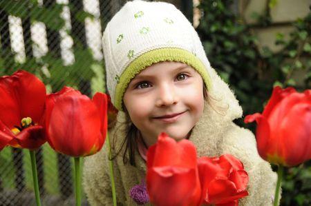 girl among tulips and looks photo