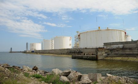 reservoirs: industrial area sea sky oil reservoirs Stock Photo