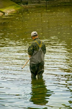 a man fishes in the river photo