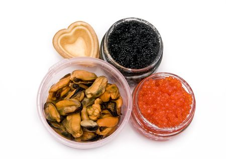 red and black caviar, mussels on a white background photo