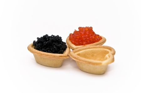 red and black caviar in a heart on a white background photo