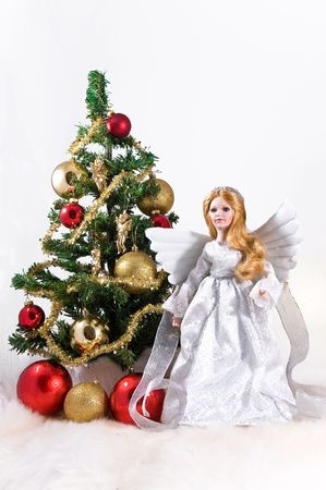Beautiful Christmas Angel isolated on white background photo