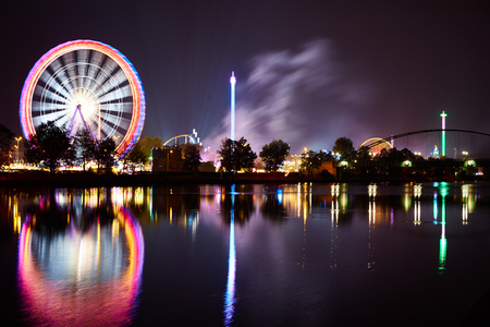 Big wheel on funfair with reflection in river