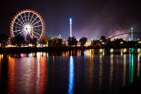 big wheel: Big wheel on funfair with reflection in river