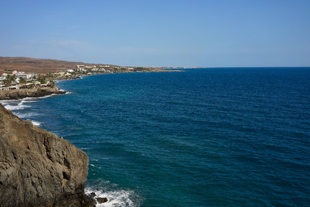 san agustin: View down the cliffs of Gran Canaria on the wide Atlantic ocean green and blue water under great cliffs of Gran Canaria