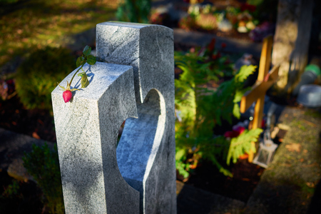 graveyard: Grave stone with heart withered rose Tomb stone with heart on graveyard Sorrow about loss of beloved ones