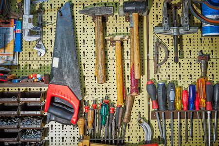 sliding caliper: Wall full of tools workbench with many tools hammers, saws, screwdrivers and co Stock Photo