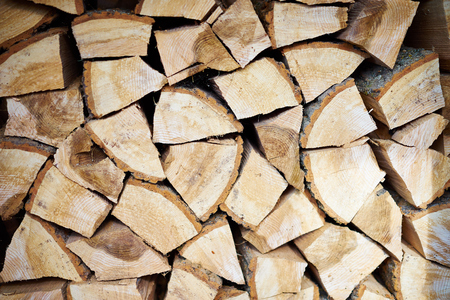 wood heating: Logs of slitted wood for heating pieces of oak and beech Stock Photo