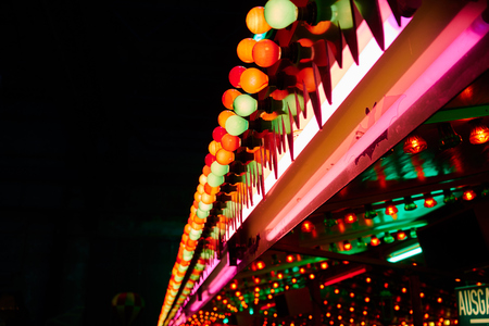 colourful lightings: colorful fluorescent bulbs on funfair Stock Photo