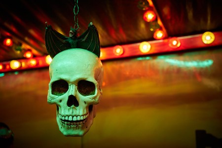 eye socket: ghost train skull with bat on steampunk funfair Stock Photo