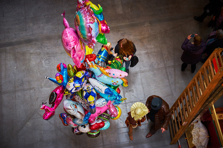 bustle: Colorful helium balloons from above Stock Photo