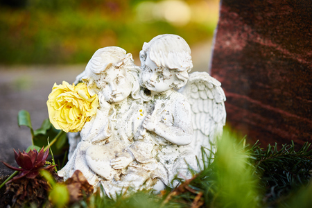 weeping angel: sad angels on grave  Angels feel sorrow Stock Photo