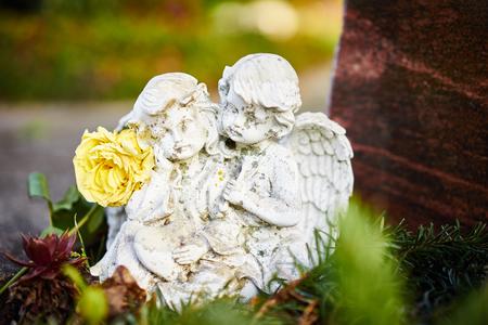 sad angels on grave  Angels feel sorrow Stock Photo