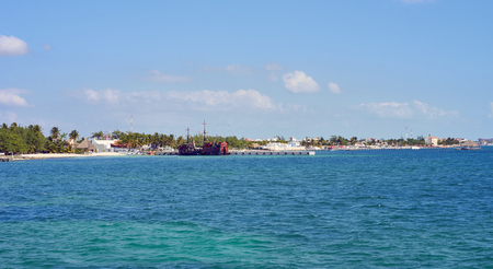 Coastline of northern Cancun at Harbor Puerto Juarez - leaving point for Isla Mujeres in Mexico  Caribbean coast with clear turquoise waters  Summer vacation in Mexico