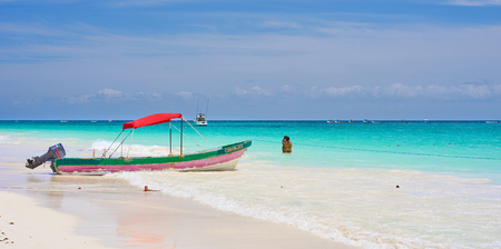 Boat with the spanish word suave that stands for soft at mexican paradise beach next to tulum  boat at caribbean beach in mexico Stock fotó
