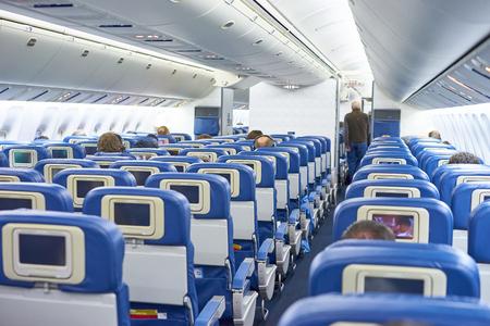 corridors: The inside of a public plane Stock Photo