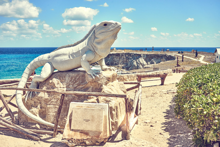 Statue of an Iguana made of stone  iguana at south end of island