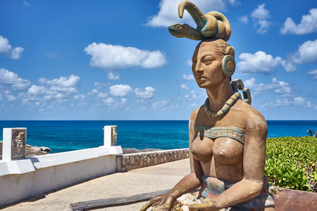Ixchel - Mayan God of Fertility  Statue of mayan god Ixchel at South Beach of Isla Mujeres in Mexico Stock Photo